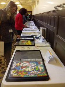 Some of the illustration portfolios on display to publishers, agents and delegates at the Melbourne Town Hall for KidLitVic 2019. Image by Anne Morgan